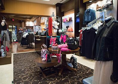 Picture of the store inside view of the Signatures shop showing clothes and accessories