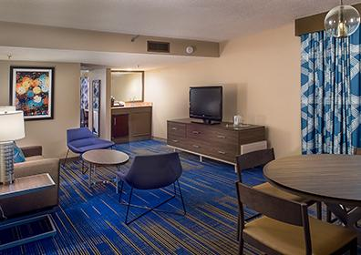 Picture of our Superior Suites with wet bar, lounge area and flat screen television