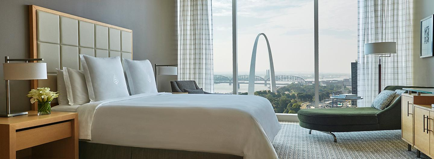 Picture of the four seasons suite with a window view of the St. Louis Arch in the background