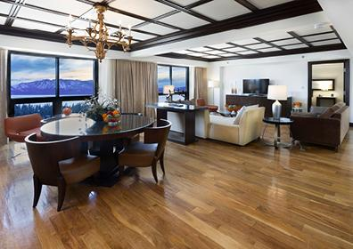 Waxed Wood Floors with Table, Couches and View of Mountain from Dining Area Window