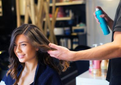 woman getting her hair done by a hair stylist