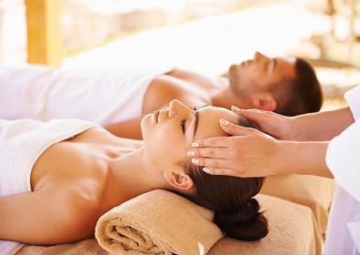 couple lying next to each other getting a massage