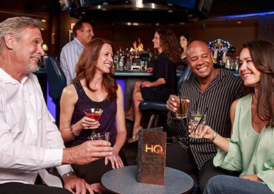 Friendly Group Enjoying Conversation Over Adult Beverages