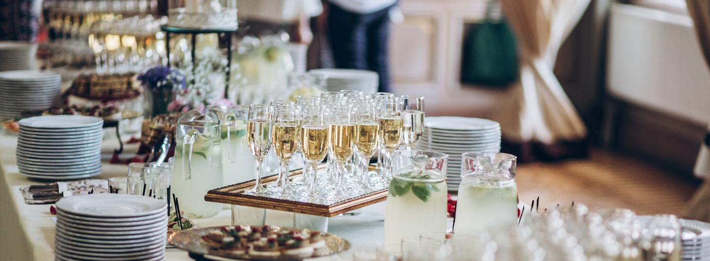 A Catering Table with Champagne and a Variety of Appetizers