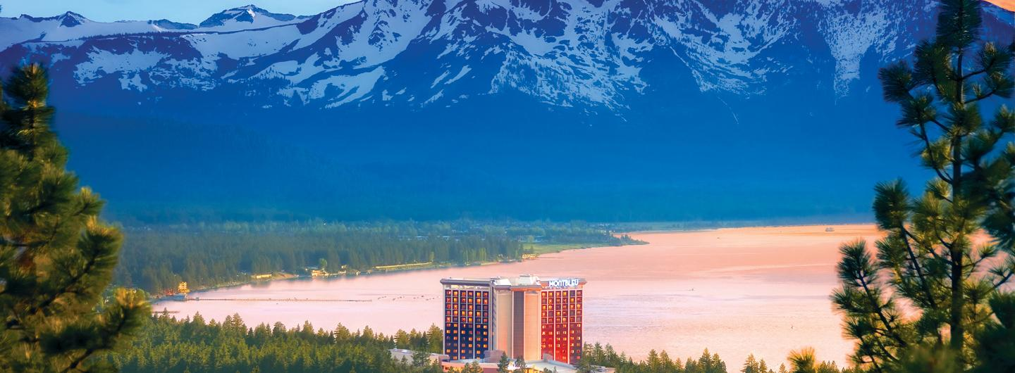 MontBleu Resort Building Against Backdrop of Lake and Mountain
