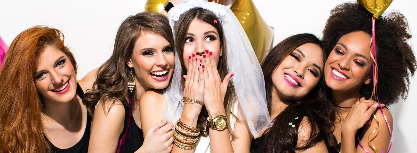 Four Women Standing on Either Side of a Bride all Having a Party