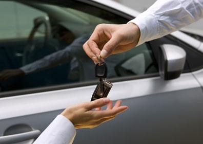 Man handing woman car keys