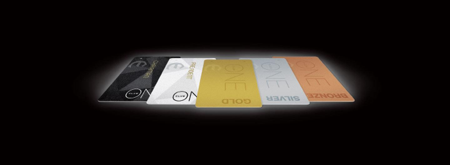 One Club cards on a black background