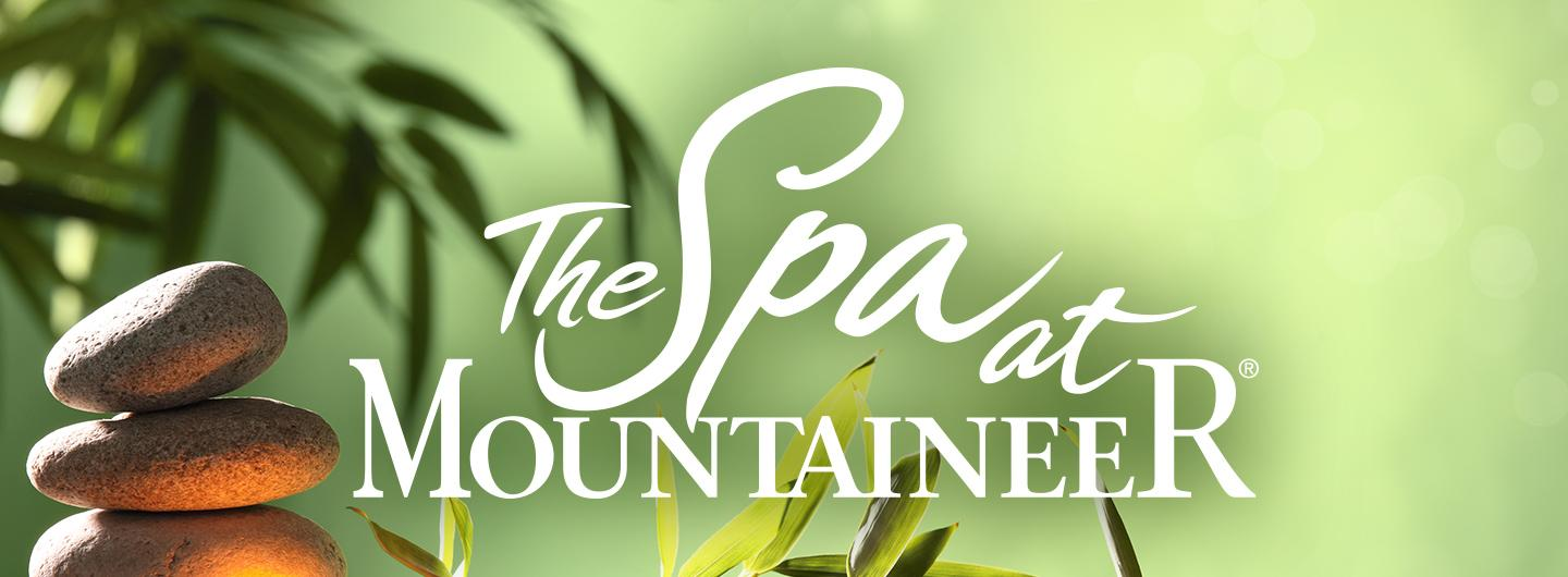The Spa logo on green background with rocks on left side