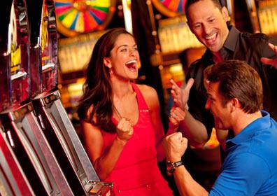People playing on slot machines in the casino.