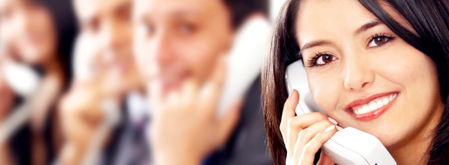 A lady smiling on the phone for contact us
