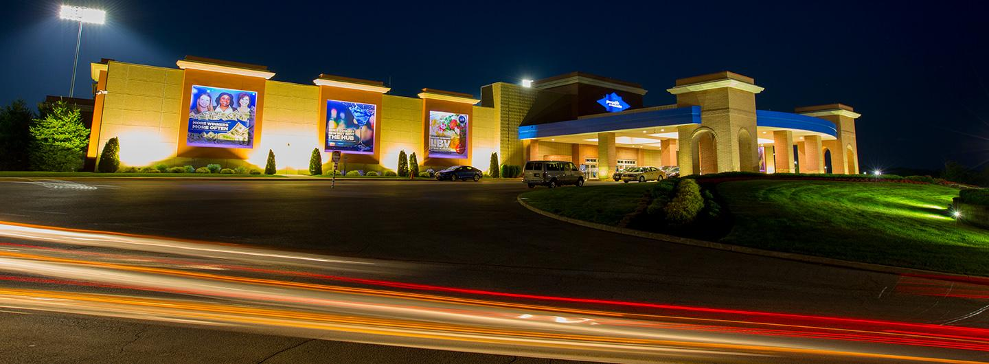 the front of presque isle downs at night with the lights on