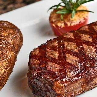 Steak and a potato at Farraddays Steakhouse