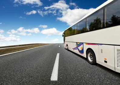 A bus driving down an empty highway
