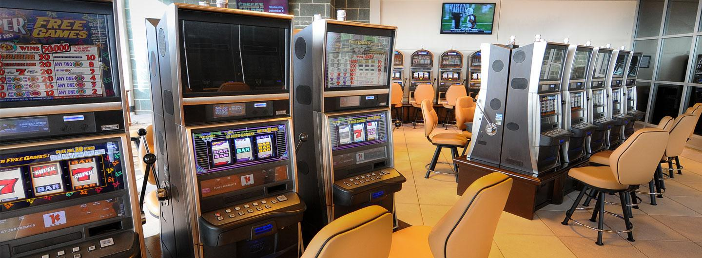 VLT machines with seating available on the Courtyard Smoking Patio at Eldorado Scioto Downs