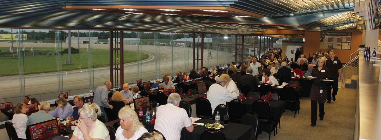 People enjoying food and a race at The Clubhouse