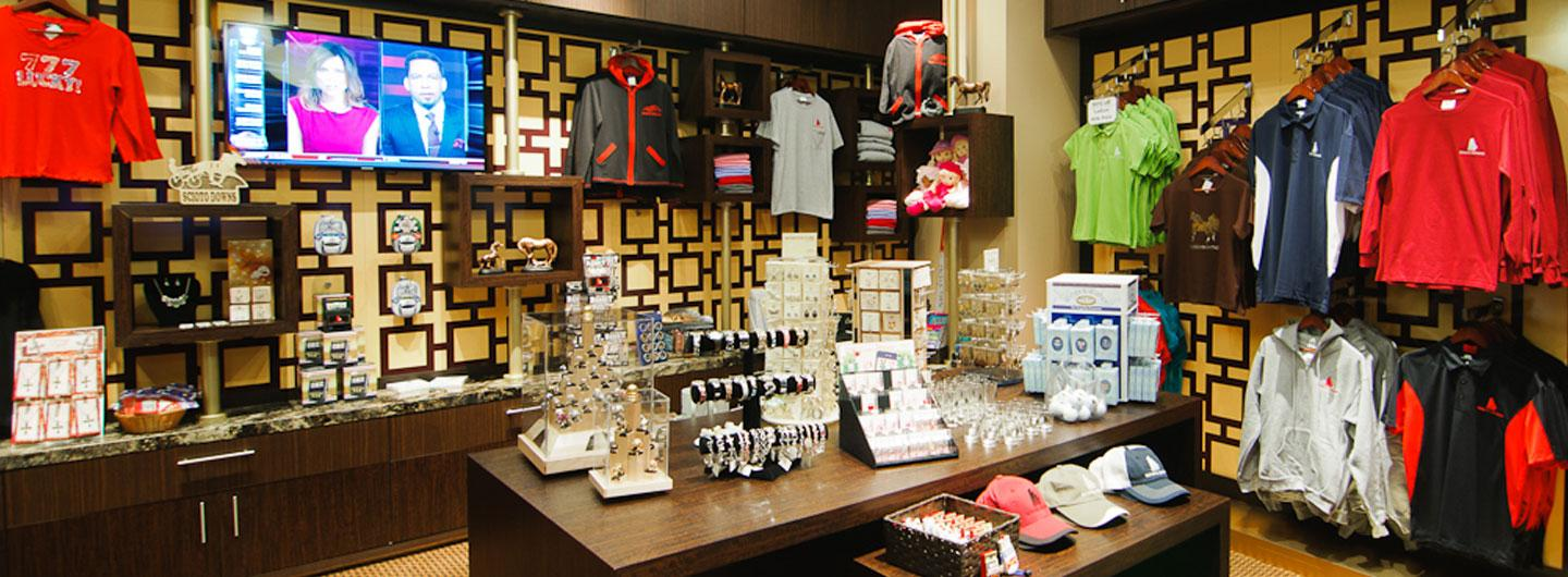 Photo of the Eldorado Scioto Downs Gift Shop featuring jewelry, shirts, hats and trinkets