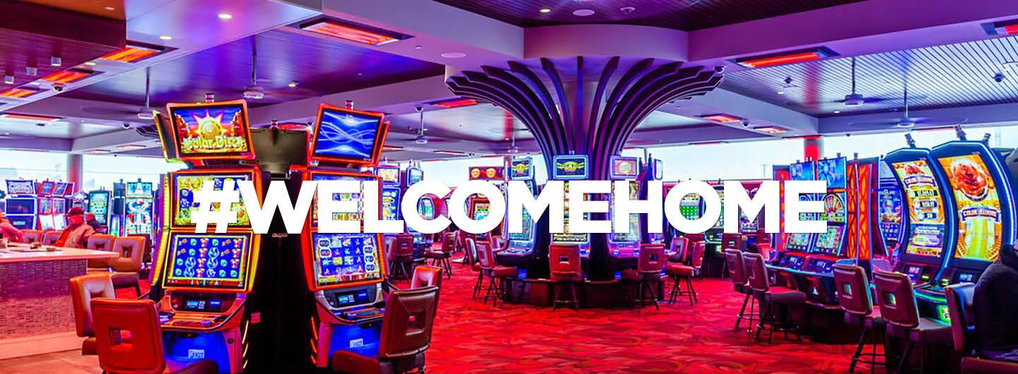 "Looking towards the gaming floor with text saying, ""#WELCOMEHOME"