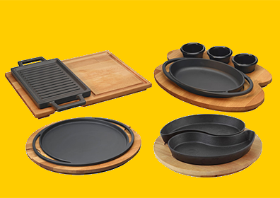 photo of 4 cast iron cookware with wood