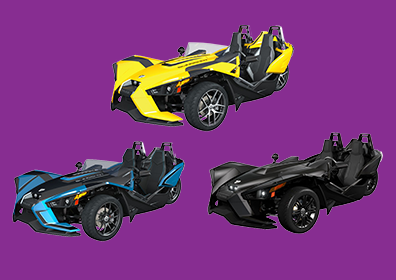 three slingshot motorcycles in yellow, blue, and black