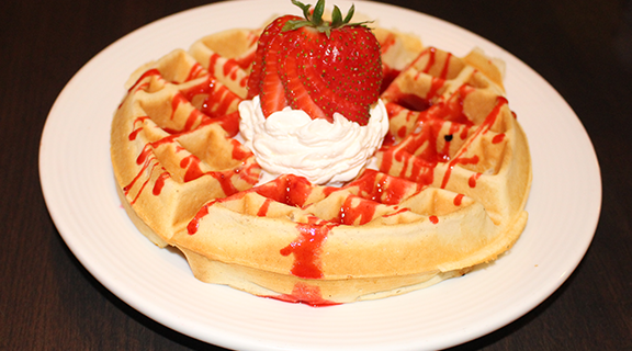 breakfast waffle with strawberry toppings