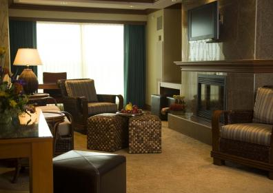 Penthouse Suite living area with gas fireplace, television and seating area
