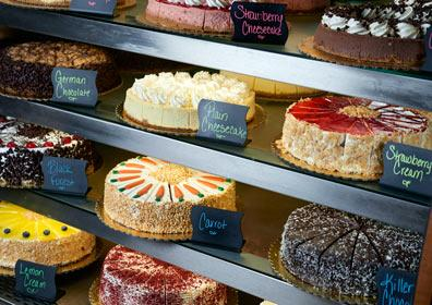 Bakery display case with delicious cakes, pies and cheesecakes