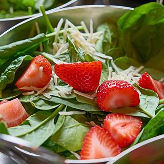 Fresh Salad with Strawberries and Cheese at Farmer's Pick Buffet