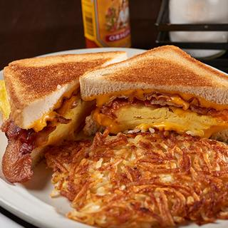 A breakfast sandwich with hash browns at The Lone Wolf