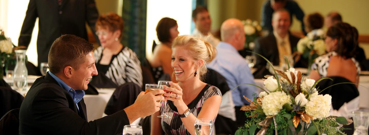 Guests toasting at a formal event in the Isle Ballroom