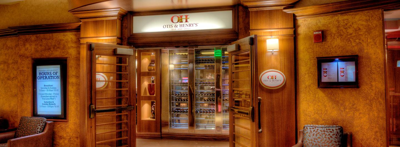 Otis & Henry's entrance doors open and showing wine cooler inside