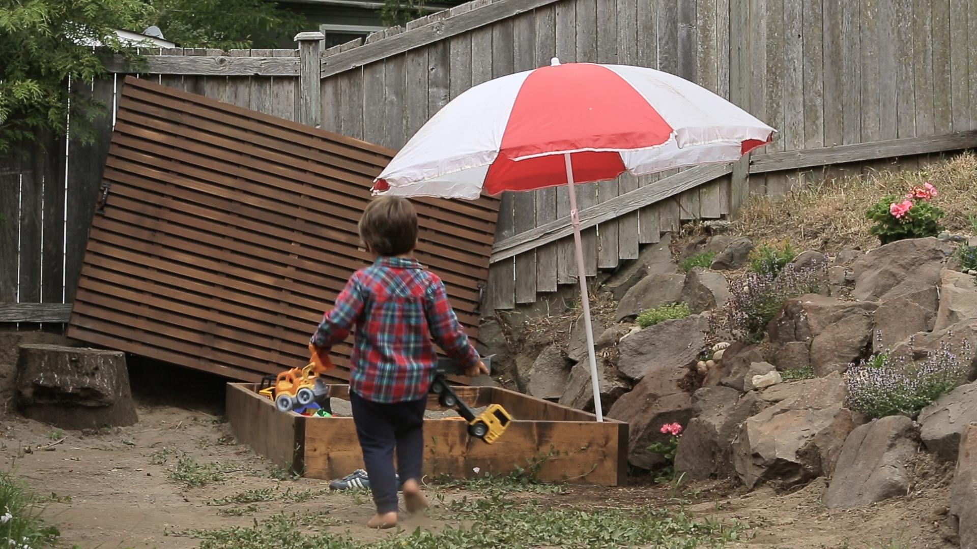 kid playing with sandbox