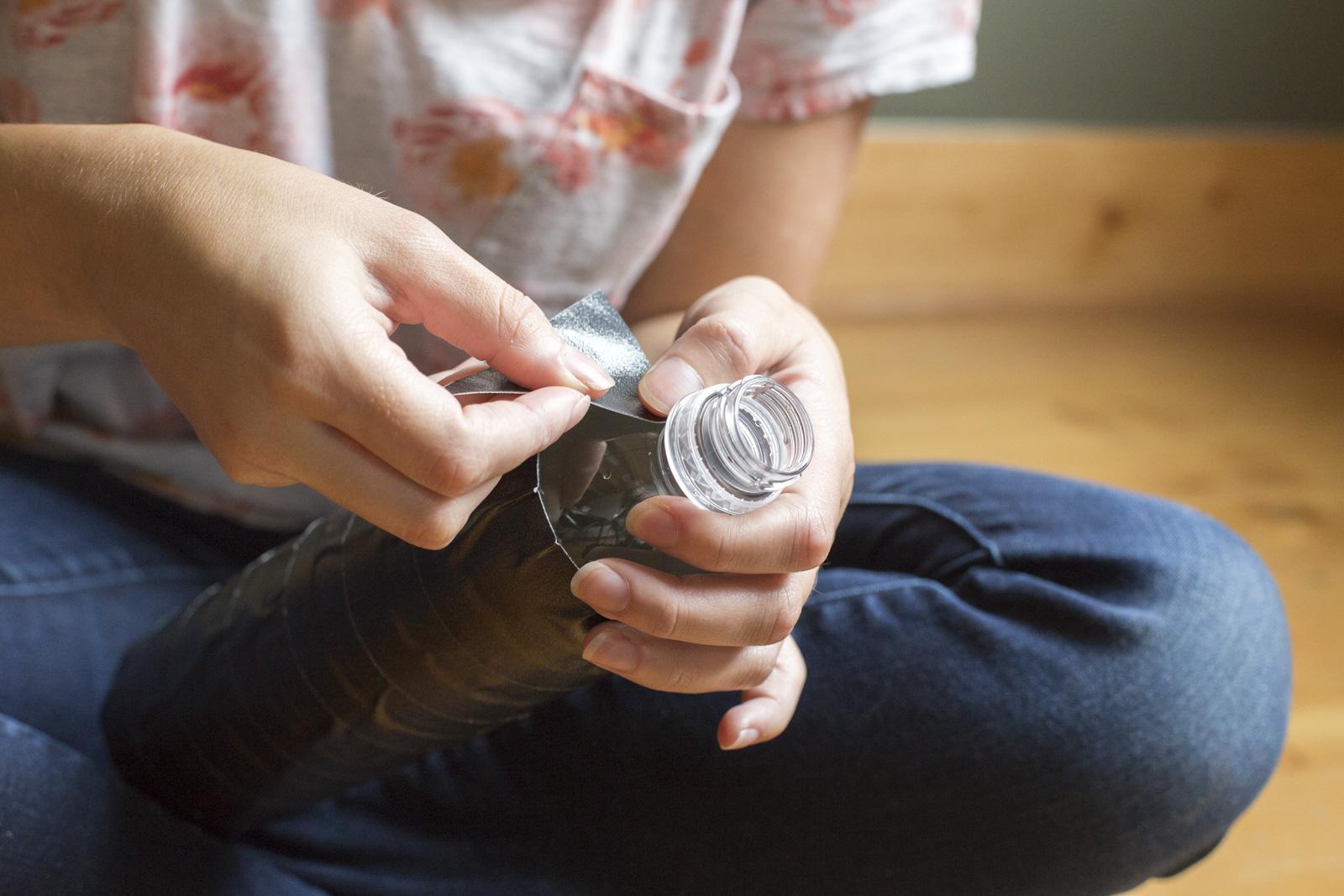 taping water bottle