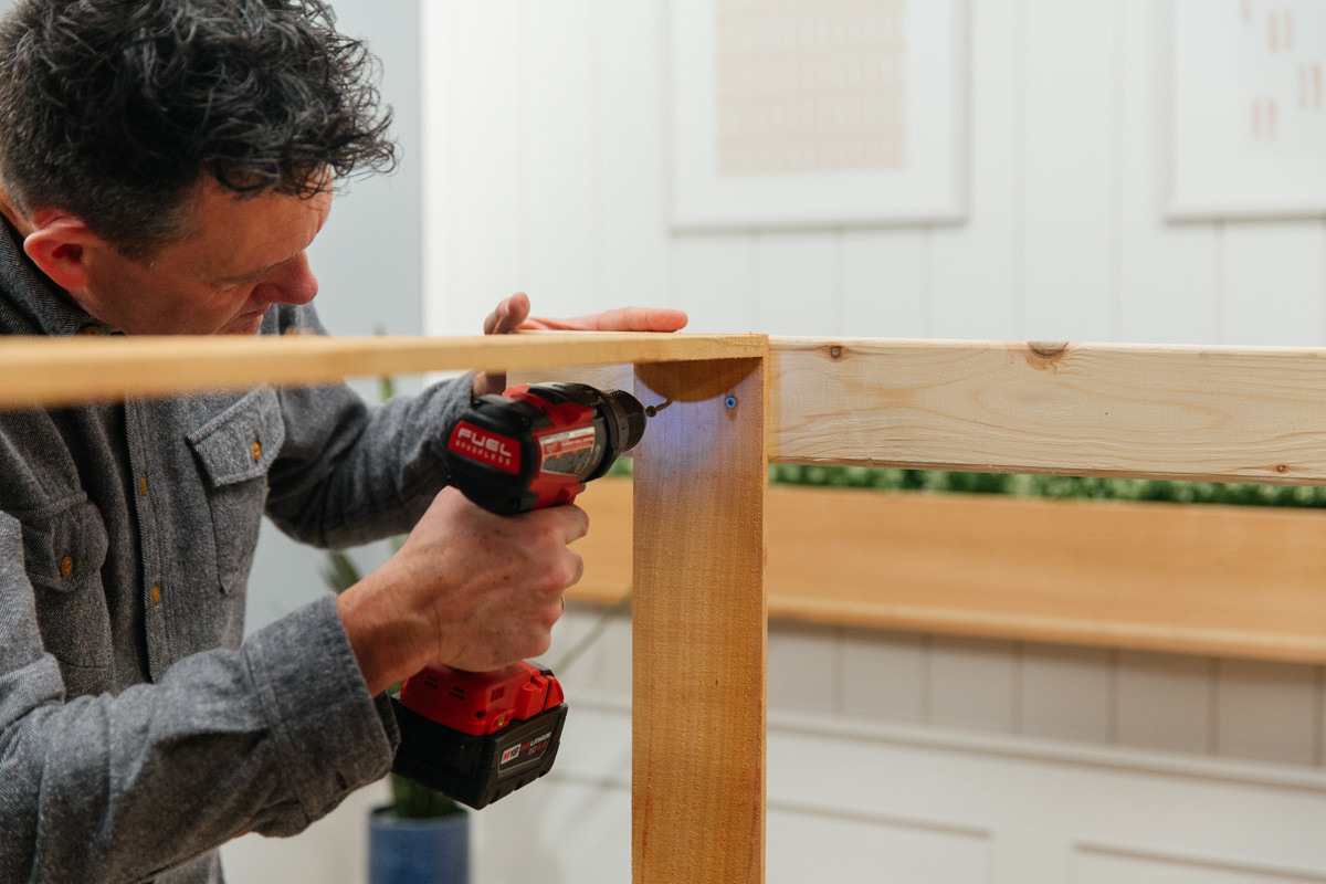 attach front legs of potting bench