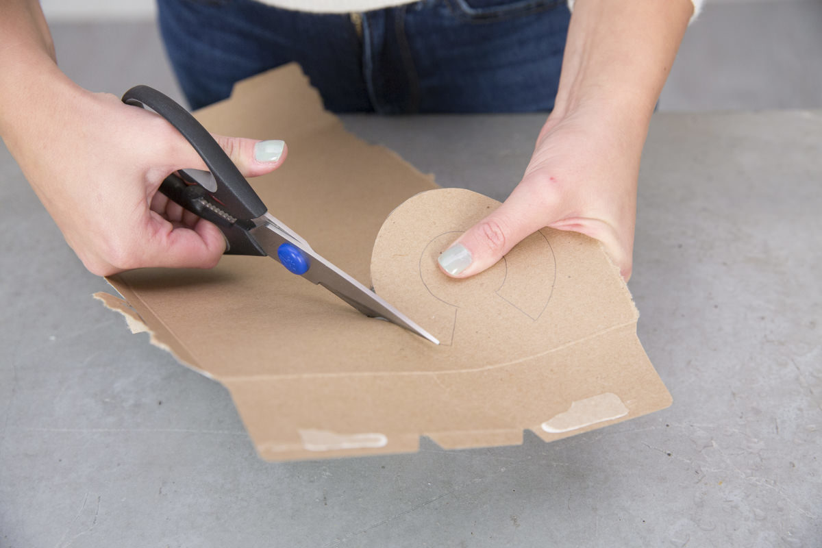 cutting out cardboard shape
