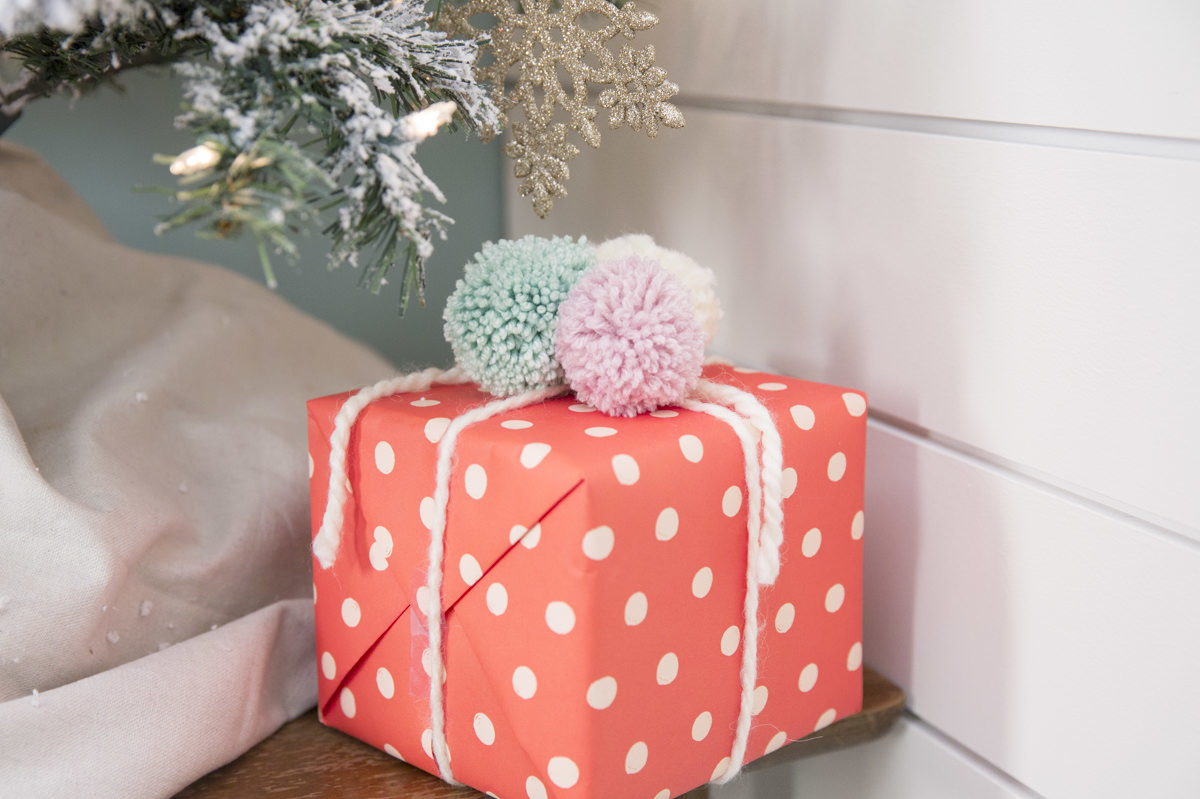 gift with pom poms