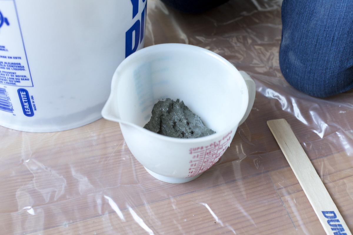pour cement into container