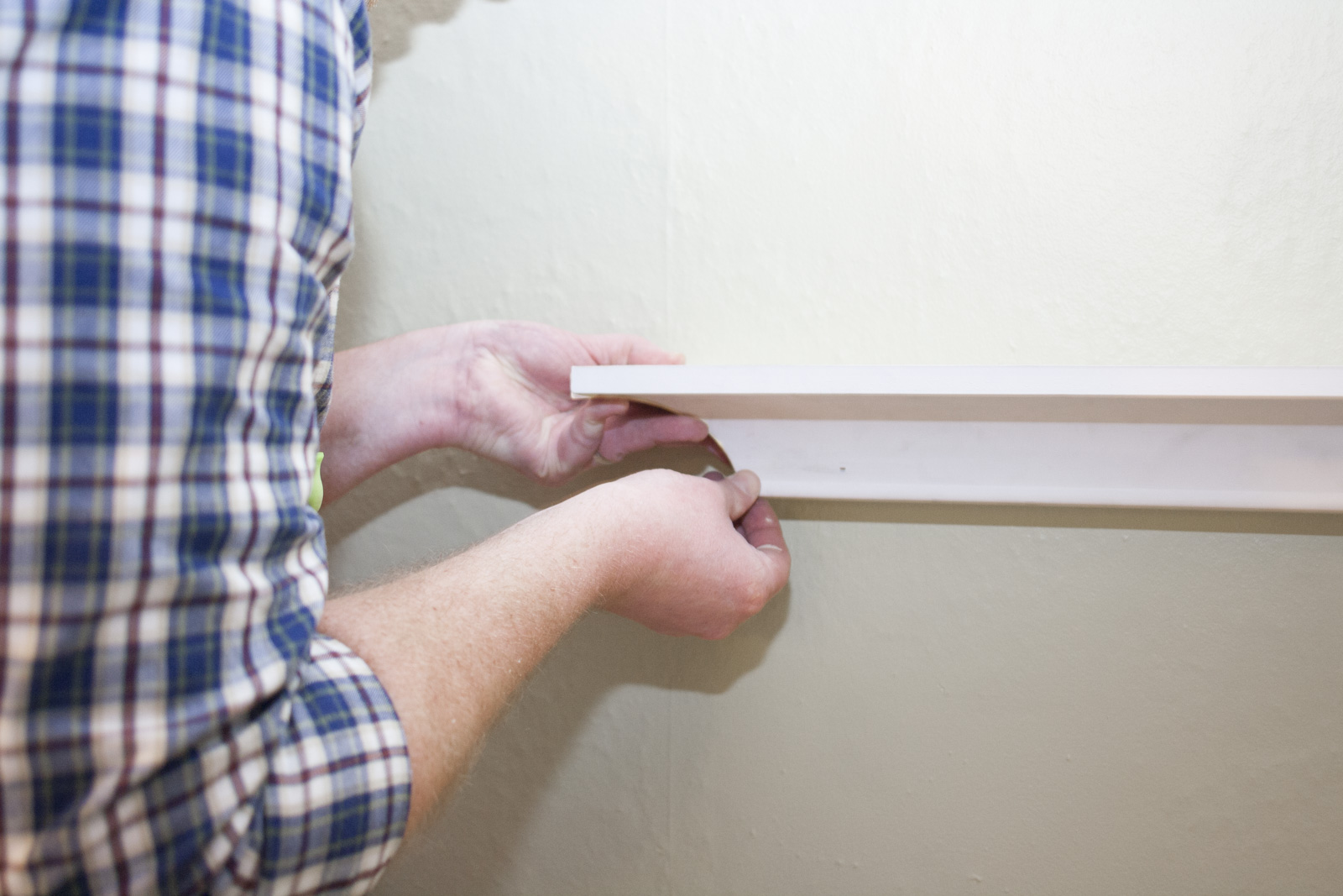gluing crown moulding to wall