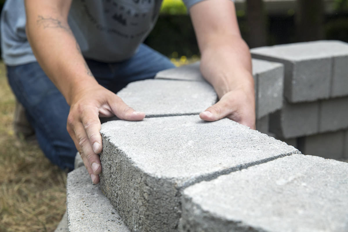 arranging windsor stone blocks for diy fire pit