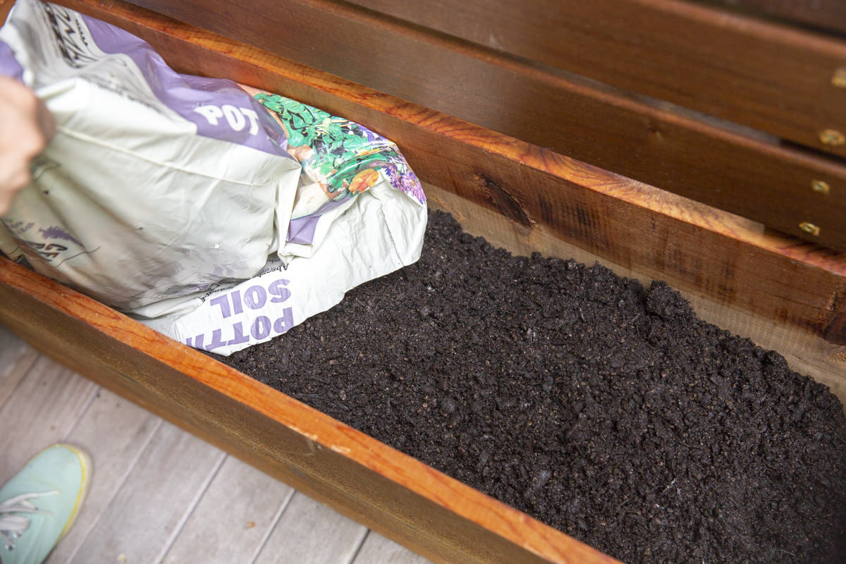 filling planter with soil