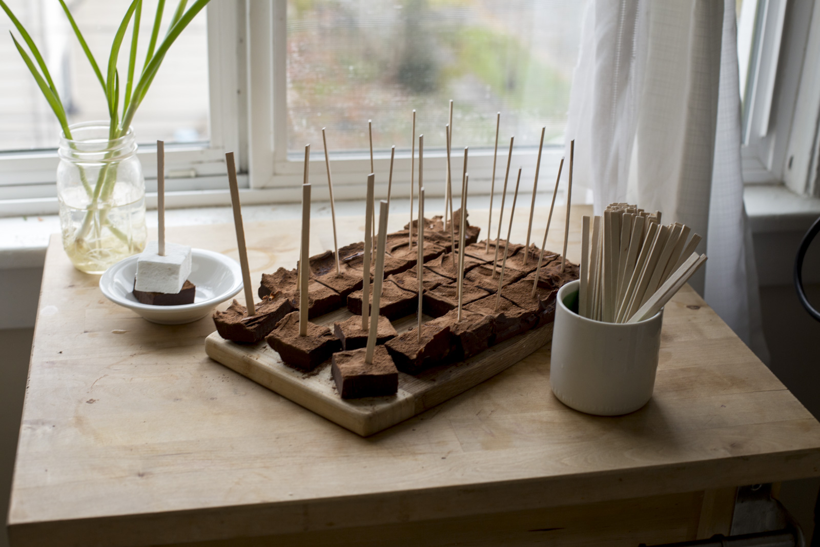 chocolate on wooden stir stick
