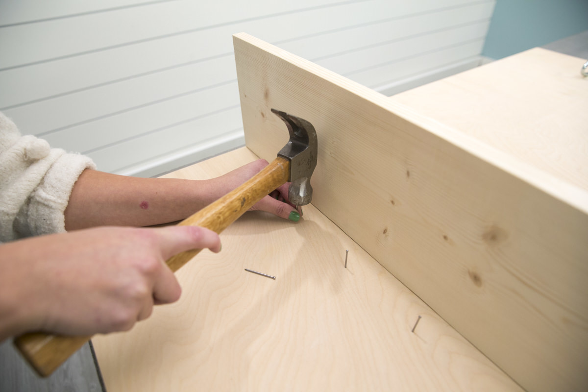 adding nail hooks to storage pegboard