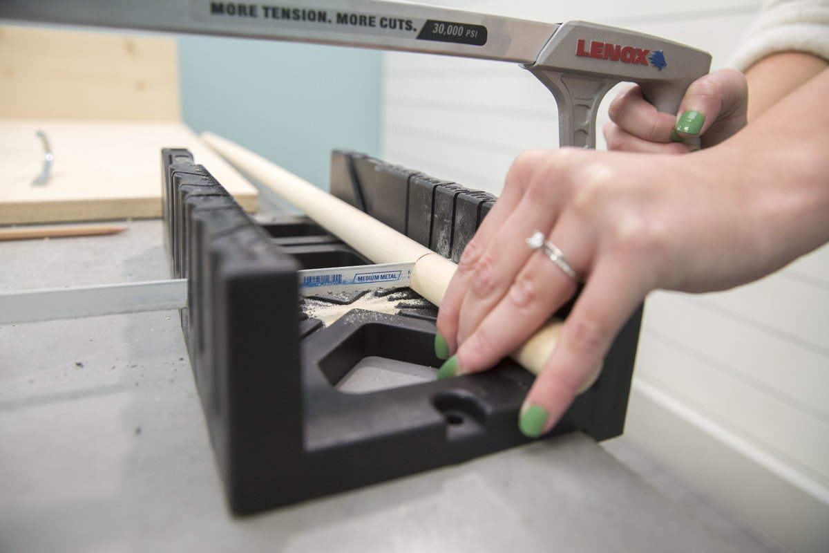 cutting dowel hooks for storage pegboard