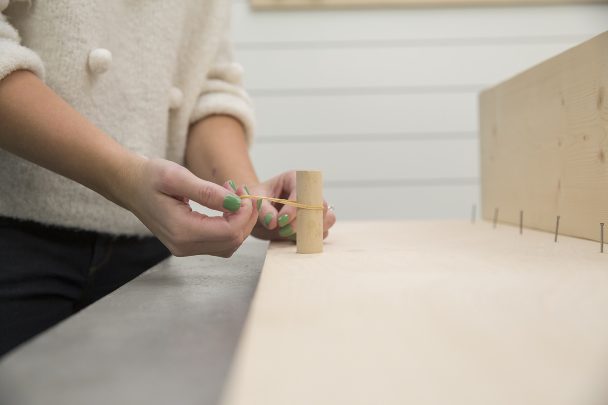 rubber band on dowel gaps for storage pegboard