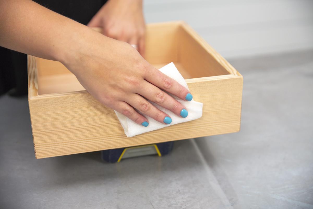 wiping down wood box