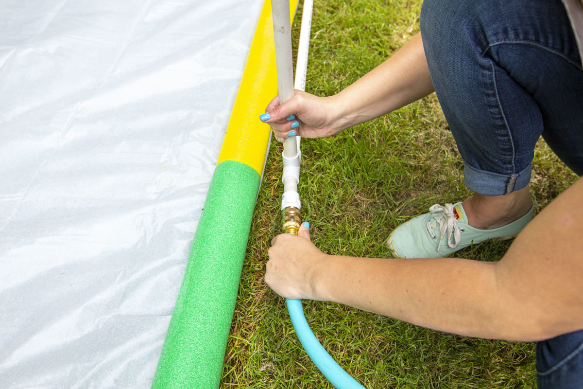 attaching hose to slip and slide frame