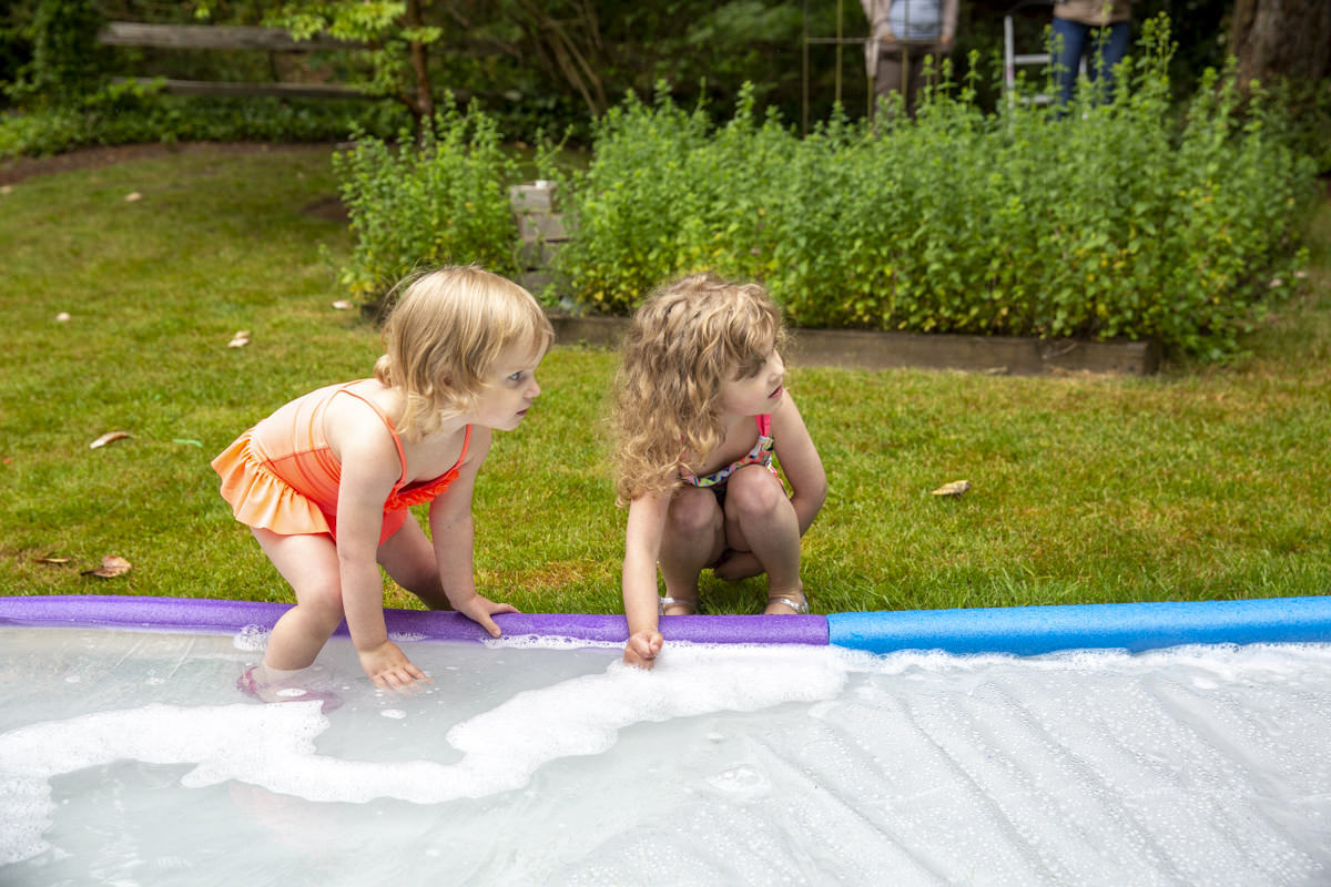 kids playing on slip and slide