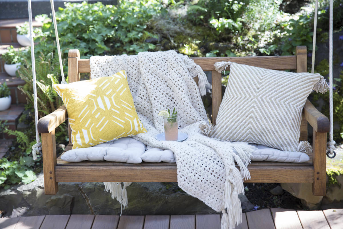 garden swing with teak oil finish and pillows