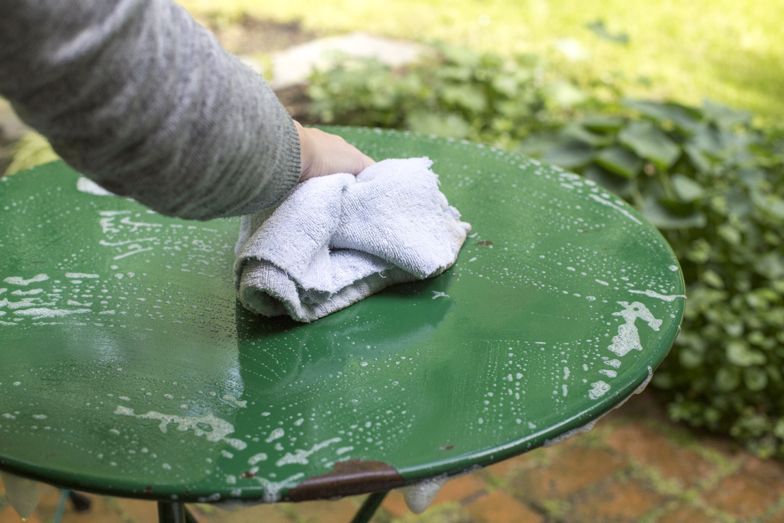 wash outdoor furniture with warm soapy water