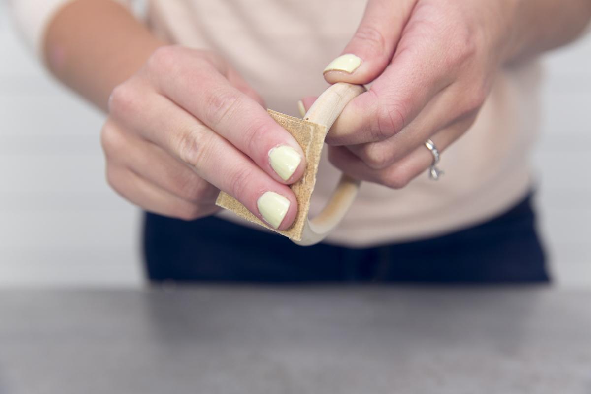 sanding wooden ring